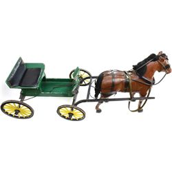 Large hand made wooden buggy and horse.