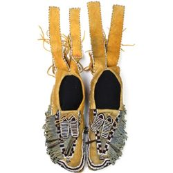 Large pair beaded and fringed ceremonial