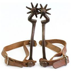 Early pair iron spurs bottle opener style shanks,