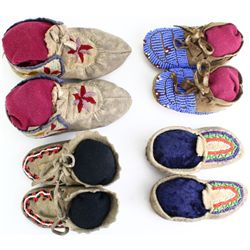 Collection of 4 pair childs moccasins.