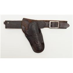Desirable R.T. Frazier, Pubelo, Colo.-marked  single loop basket weave holster and matching  un-mark
