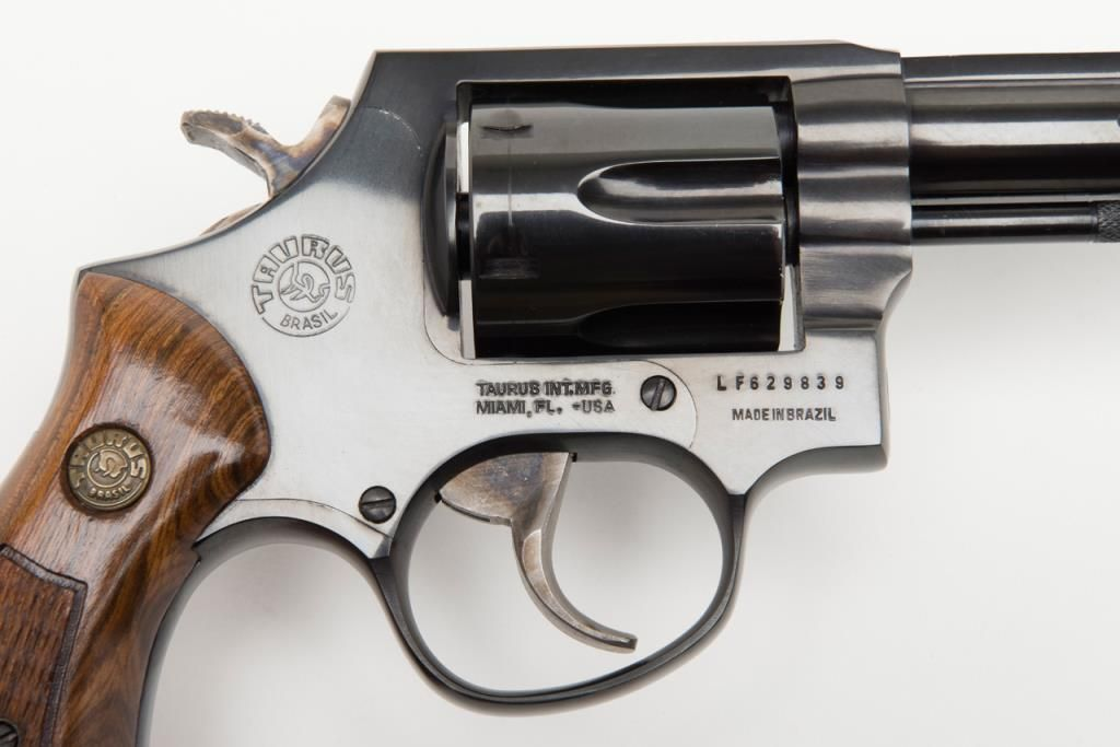 "Taurus Model 82 DA revolver,  38 Special cal , 4"" barrel, blue finish,  checkered wood medallion gr"