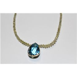 CHOKER LENGTH FACETED DIAMOND BEAD NECKLACE WITH A NATURAL BLUE TOPAZ PENDANT.  39CM  STAND OF