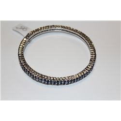 STERLING SILVER BANGLE STYLE BRACELET SET WITH PROMO QUALITY BLUE SAPPHIRES.  BEAD