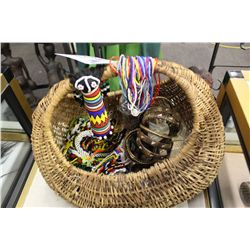 BASKET CONTAINING DOZENS OF RATTAN AND BEADED BRACELETS
