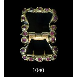 Gold-and-ruby buckle, ornate and intact  from 1715 Fleet.