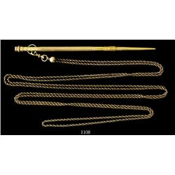 Gold stylus with ruby and long chain, 1800s, South American.