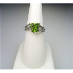 Stylish Trilliant cut Peridot and Diamond Ring.