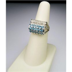 Pretty Ribbon Style Blue Topaz and Diamond Ring.
