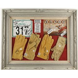 Glass framed display of PBR gloves and autographs