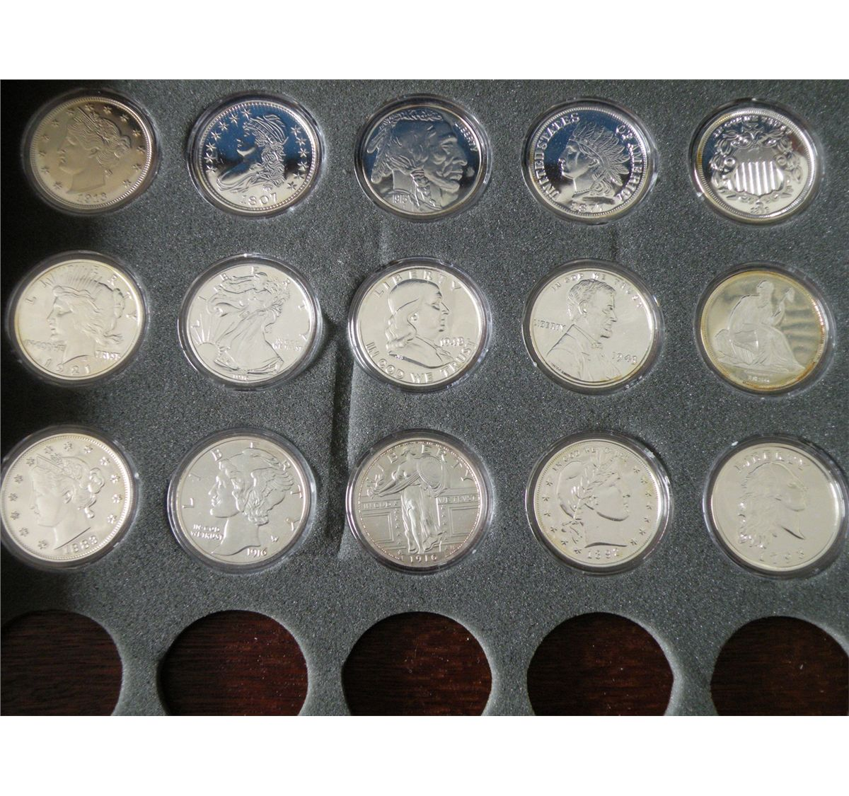A Partial Set Of Oversized Apparently Silver Plated Us Coin Replicas In