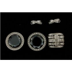 RING: [1] Gents dia and 10kwg ring 22mm wide and channel set with (80) baguette dias and (42) prince