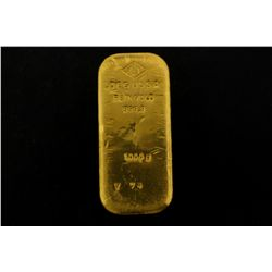 BULLION: [1]  One kilogram Degussa .9999 fine gold bar.