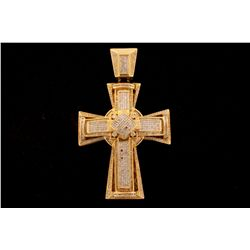 PENDANT:  [1] 10KYG cross pendant with a 14KYG bail is set with round, baguette and princess cut dia