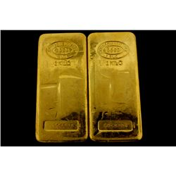 BULLION: [2] One kilogram Johnson Matthey .9999 fine gold bars.