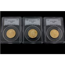 COINS: [3] $25 American Eagle gold coins, 1/2 oz, slabbed and graded PCGS MS69, 2000.