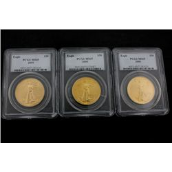 COINS: [3] $50 American Eagle gold coins, 1 oz, slabbed and graded PCGS MS69, 2000.