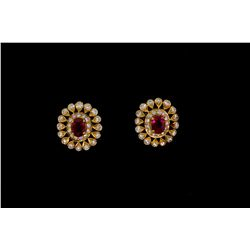 EARRINGS: [1] Pair 18kyg ruby and diamond earrings. Center ruby is 6.00mm x 4.00mm of commercial qua