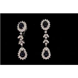 "EARRINGS: [1] Pair 18kwg sapphire and dia dangle earrings 2"" long, set with (4) 7.00mm x 5.00mm oval"