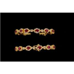 BRACELETS: [2] Sets of ruby and diamond 22kyg bangles. Each has (14) 5.00mm x 4.00mm oval faceted ru