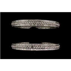BRACELETS: [2] 18kwg dia bangles. Each has approx. (310) baguette dias and (93) marquise cut dias SI