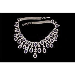 NECKLACE: [1] 18kwg sapphire and dia fringe style necklace. Set with  (28) 7.00mm x 5.00mm oval sapp