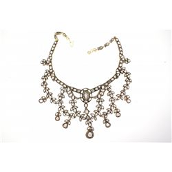 NECKLACE: [1] 14kyg silver topped bib style necklace set with (192) uncut (Polki) dias and (55) rbc