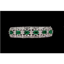 BRACELET: [1] 18kwg emerald and dia bangle prong set with (6) 6.00mm x 4.00mm rectangular emeralds,