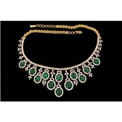 NECKLACE: [1] 18kyg emerald and dia necklace set with (12) oval emerald cabochons commercial to good