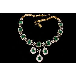 "NECKLACE: [1] 18kyg necklace 20"" long (9) emerald cut emeralds, (3) pear shaped emeralds, commercial"