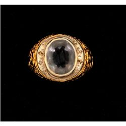 RING:  [1] 18KY & WG ring set with 1 oval faceted synthetic stone, size 10 3/4;  10.5 grams  [stone