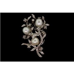 BROOCH: [1] 14kwg, pearl and diamond pin 2 1/2'' x 2'' wide with (3) 10.0 - 10.5mm egg shaped South