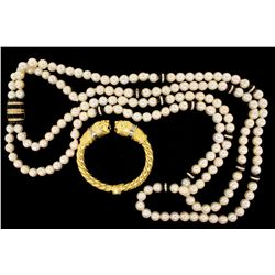 NECKLACE: [1] Double strand necklace of slightly baroque 9 to 10mm pearls that have blemishes and 12