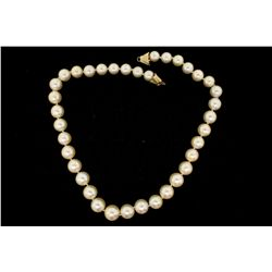 PEARLS: [1] Single strand of 10.0 to 14.3mm brownish-light golden color South Sea pearls with a 14KY