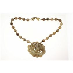 NECKLACE: [1] Single strand necklace of 14mm brownish green hard stone beads with small brass beads