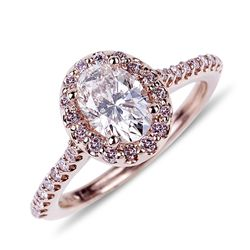 APP: 34.2k *14 kt. Gold, 1.08CT Oval Cut Diamond And 0.33CT Fancy Pink Diamond Ring