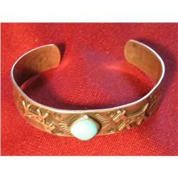 801.Silver and turquoise bangle style bracelet, has deer and Native American hieroglyphics, marked