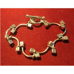 "819. HEAVY, solid link bracelet – links are made of ""cubes and curves"", marked 925 – interesting and"