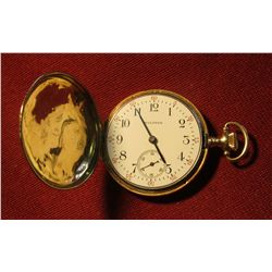 828.14K Waltham pocket watch, case is marked 14K 0.585 FINE GUARANTEED. Winds, runs, keeps time. We