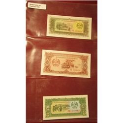 1561. (3) Crisp Unc Laos Bank notes. 5, 10, & 20 Riels. All stored in a plastic page.