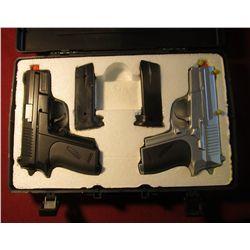 1598. New Pair CYMA Air Sport Guns in a case.