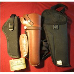1603. BU ck Honemaster No. 136 in original case; (2) black Uncle Mike style Pistol Holsters; Hunter