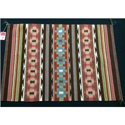Navajo Weaving by Cordelia Chatter