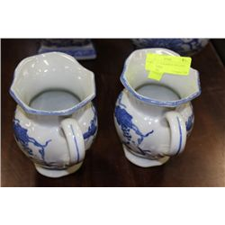 PAIR OF BLUE & WHITE PITCHERS