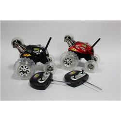PAIR OF 'THUNDER TUMBLER' REMOTE CONTROL CARS