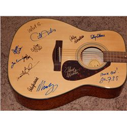 WOODSTOCK - ACOUSTIC GUITAR SIGNED BY OVER A DOZEN WOODSTOCK ACTS