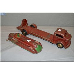 Vintage stamped steel toys including wind up race car and Elwood Productions truck, both made in Can