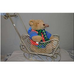 A large 1985 Bialosky Bear by Gund in a metal push sled