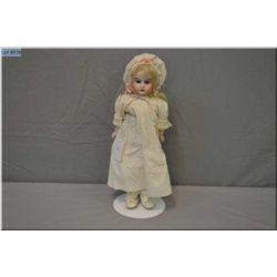 """Cabinet sized 12"""" Huebach Kopplesdorf bisque shoulder head doll with bisque arms on a kid leather bo"""