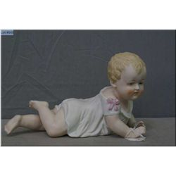 """10"""" hand painted German piano baby marked 23/109. Auction estimate $75-$100"""